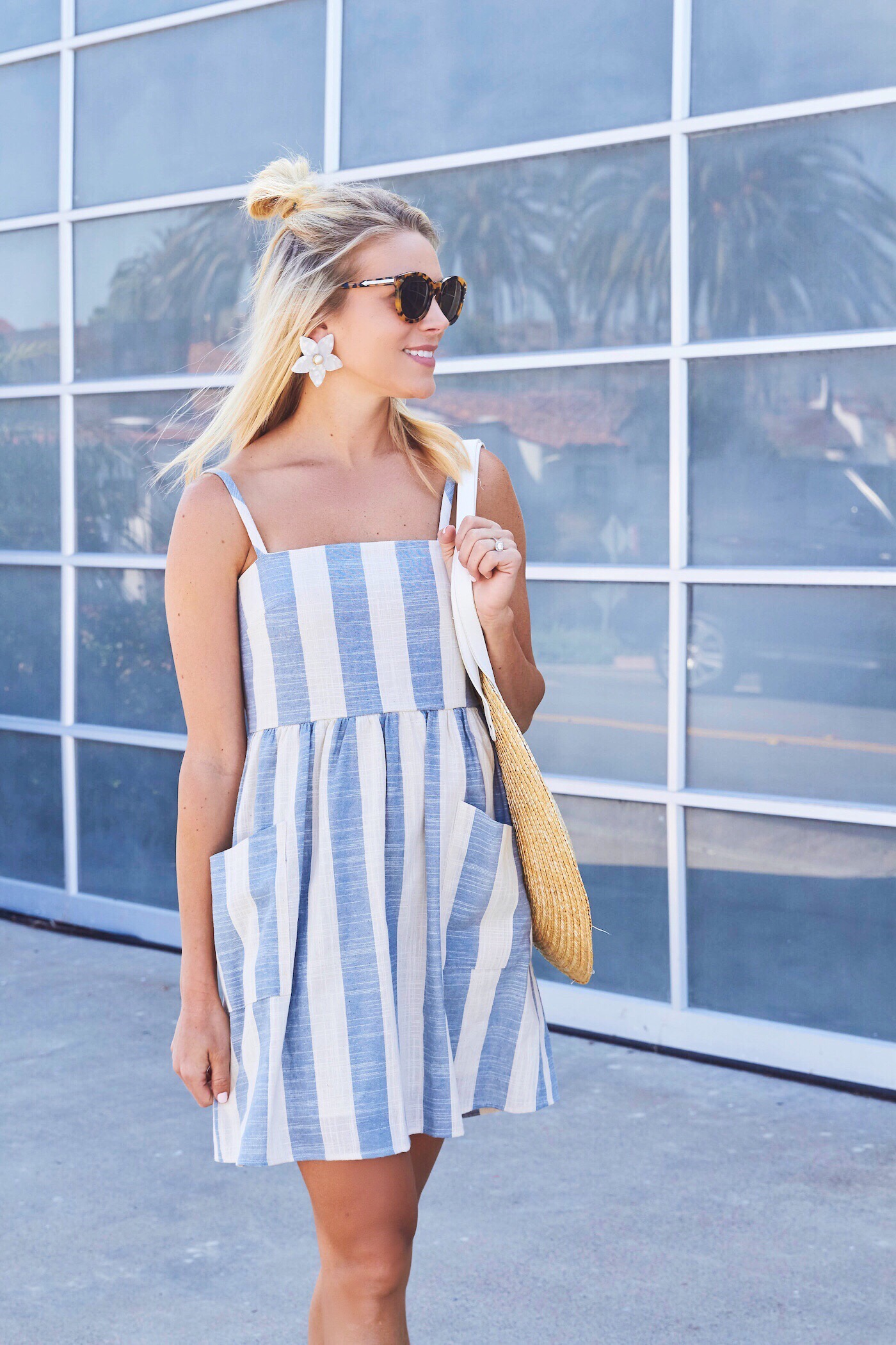 It has been getting pretty warm here in San Diego and I love having easy  dresses to throw on during the summer months. This striped linen dress is  under  50 ...